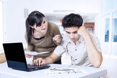 Couple paying bills online Stock Photos