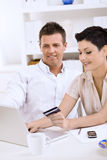 Couple paying with credit card Stock Photo