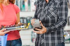 Couple Paying For Flashlight Through Smartphone In Stock Photos