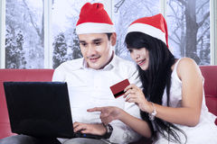Couple paying online in christmas day Royalty Free Stock Photo