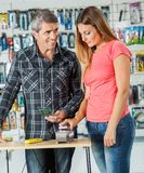 Couple Paying Through Smartphone In Hardware Store Royalty Free Stock Photo