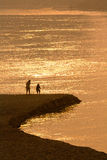 Couple on peaceful beach. At rim to look shiny river stock images