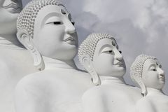 Couple peaceful white buddha statues sitting well alignment and decorating wonderful attractive mirror. One of the most interesting landmark in north of stock photo