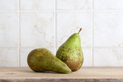A couple of pears on a chopping board Stock Image