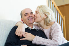 Couple pensioners together on sofa at home Stock Images
