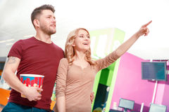Couple of people standing and pointing upwards Stock Photo