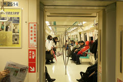 A couple of people are taking  a clean subway train in Taipei, Taiwan. Stock Image