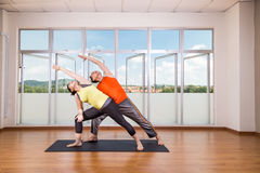 Couple perform series of Extended Side Angle yoga partner pose Stock Images