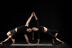 Couple performing acroyoga Royalty Free Stock Photos