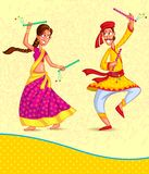Couple performing Dandiya Royalty Free Stock Images