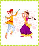 Couple performing Dandiya Stock Photography