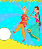 Couple performing Dandiya Stock Images
