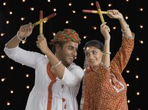 Couple performing Dandiya Raas on Navratri Stock Photos