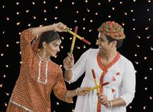 Couple performing Dandiya Raas on Navratri Stock Photos