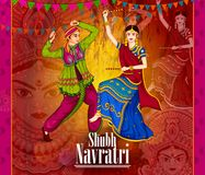 Couple performing Garba dance in Dandiya Raas for Dussehra or Navratri Stock Image