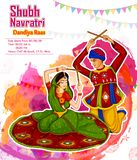 Couple performing Garba dance in Dandiya Raas for Dussehra or Navratri Royalty Free Stock Images