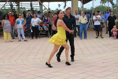 Couple dancing at a festival in Miami. Couple performing in traditional dress dancing salsa in front of crowd at a rodeo festival in Miami, Florida. outdoors Royalty Free Stock Images