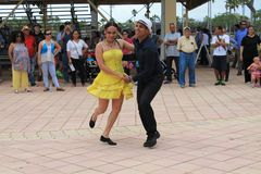 Couple dancing at a festival in Miami. Couple performing in traditional dress dancing salsa in front of crowd at a rodeo festival in Miami, Florida. outdoors Royalty Free Stock Photography
