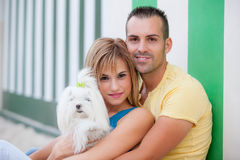 Couple with pet dog. Happy smiling family group Royalty Free Stock Image