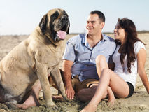 Couple and pet dog Stock Photo