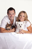 Couple with pet dogs. Portrait of happy couple with two pet dogs Stock Images