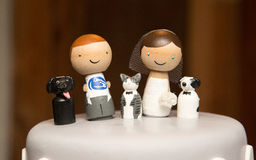 Couple with pets on wedding cake Royalty Free Stock Image