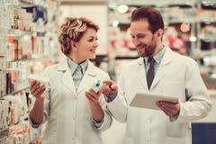 Couple of pharmacists royalty free stock photo
