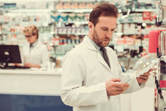 Couple of pharmacists stock photography