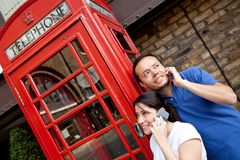 Couple on the phone Royalty Free Stock Images