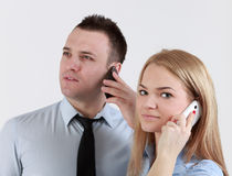 Couple on the phone. Close-up of a young couple using mobile phones Royalty Free Stock Image