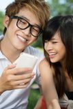 Couple with phone Stock Image