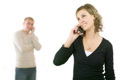 Couple on phone Royalty Free Stock Photos