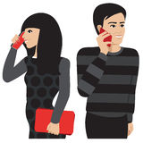 Couple phone. A happy dark haired couple communicating by cellphone Royalty Free Stock Images