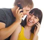 Couple on the phone together Royalty Free Stock Photography