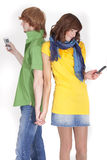 Couple with phones Royalty Free Stock Photo