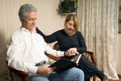 A Couple With a Photo Album-Horizontal Stock Images