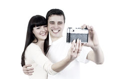 Couple with photo camera Royalty Free Stock Photos