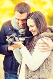 Couple with photo camera in autumn park Royalty Free Stock Images