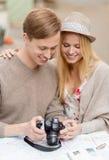 Couple with photo camera Stock Photos