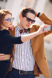The couple is photographed with smartphone in the city Royalty Free Stock Image