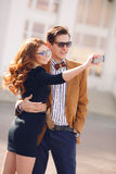 The couple is photographed with smartphone in the city Stock Image