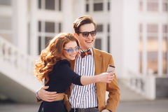 The couple is photographed with smartphone in the city Stock Photo