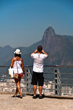 Couple photographing Christ the Redeemer in Rio de Janeiro, Brazil Royalty Free Stock Photo