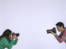 Couple Photographing Each Other In Studio Stock Photography