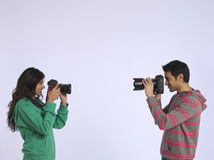 Couple Photographing Each Other In Studio Stock Photos