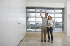 Couple Photographing Empty Apartment Royalty Free Stock Photo