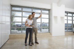 Couple Photographing Empty Apartment Royalty Free Stock Image