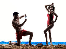 Couple photographing selfie on the beach Stock Image
