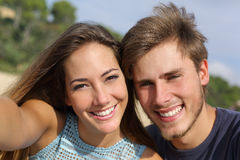 Couple photographing a selfie with the smart phone stock image
