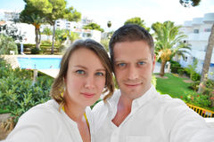 Couple photographing themselves. Royalty Free Stock Images